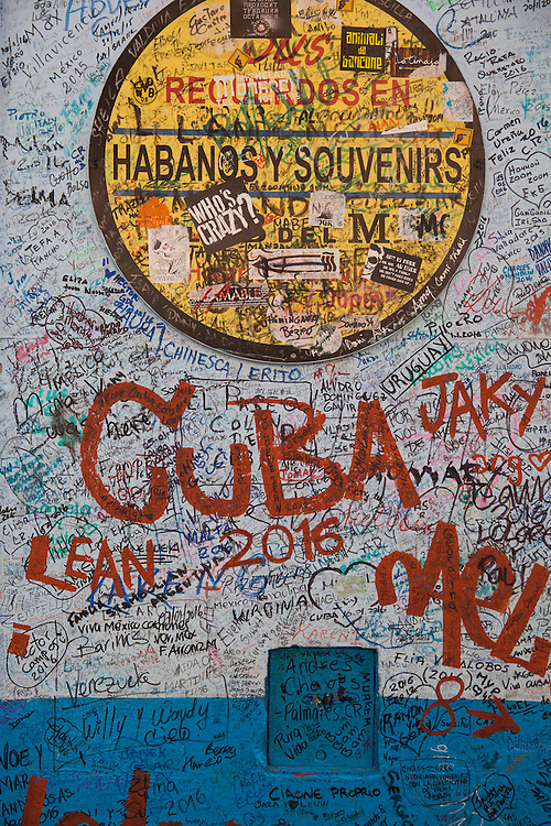 Wall painted with thousands of messages right outside the famous bar 'La bodeguita del medio' in Old Havana, Cuba.
