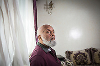 CASABLANCA, MOROCCO - 14 MAY 2016: Luqman Abdul-Hakeem (82), a close follower of Malcolm X that chauffeured the African American activist around and introduced him to Cuban leader  Fidel Castro in September 1960, poses for a portrait in his home in Sidi Maarouf, a district of Casablanca, Morocco, on May 14th 2016.<br /> <br /> Born in Cleveland, OH, in 1934, Luqman Abdul-Hakeem was raised in Flushing, Queens, and then moved to Bayside, where he graduated in 1952. He attended the New York Technical University for a few months before enrolling in the Navy, where he stayed for two years. Though he had asked for ship duty, he ended up in Springfield, Mass., and Glennclose, Ill. He moved to Brooklyn when his hitch was done and by 1966 was studying jujitsu and aikido. He met Malcolm X during one of his sermons on 116th street in Harlem, New York, in the late 50's. In 1985, Mr. Hakeem decided to move to Marocco because America wasn't a country where he wanted to raise hois children. He has been teaching aikido in the two dojos he owns in Casablanca until 2014, when he underwent a surgery.