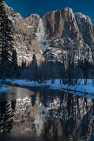 On Swinging Bridge (over the Merced River) looking at the sunrise illuminating Yosemite 'snow' Fall. The temperature was around 15 deg F. The water fall turns to snow on the way down.