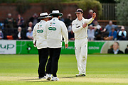 The umpires inform Tom Abell of Somerset they have warned Craig Overton of Somerset for bowling too many short balls during the Specsavers County Champ Div 1 match between Somerset County Cricket Club and Worcestershire County Cricket Club at the Cooper Associates County Ground, Taunton, United Kingdom on 22 April 2018. Picture by Graham Hunt.