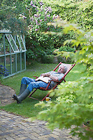 Gardener sleeps on deckchair in back garden