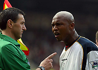 Liverpool's El-Hadji Diouf argues with a biased linesman against Manchester United during the Premiership match at Old Trafford, Manchester, Saturday, March 5th, 2003.<br /><br />Pic by David Rawcliffe/Propaganda<br /><br />Any problems call David Rawcliffe +44(0)7973 14 2020 david@propaganda-photo.com http://www.propaganda-photo.com