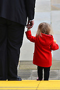 © Licensed to London News Pictures. 03/10/2012. Manchester, UK A young girl wearing a red coat leaves the conference centre on Day 5 at The Labour Party Conference at Manchester Central today 3rd october 2012. Photo credit : Stephen Simpson/LNP
