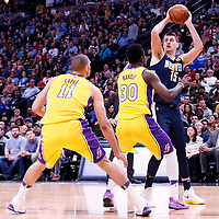 09 March 2018: Los Angeles Lakers forward Julius Randle (30) and Los Angeles Lakers center Brook Lopez (11) defend on Denver Nuggets center Nikola Jokic (15) during the Denver Nuggets125-116 victory over the Los Angeles Lakers, at the Pepsi Center, Denver, Colorado, USA.