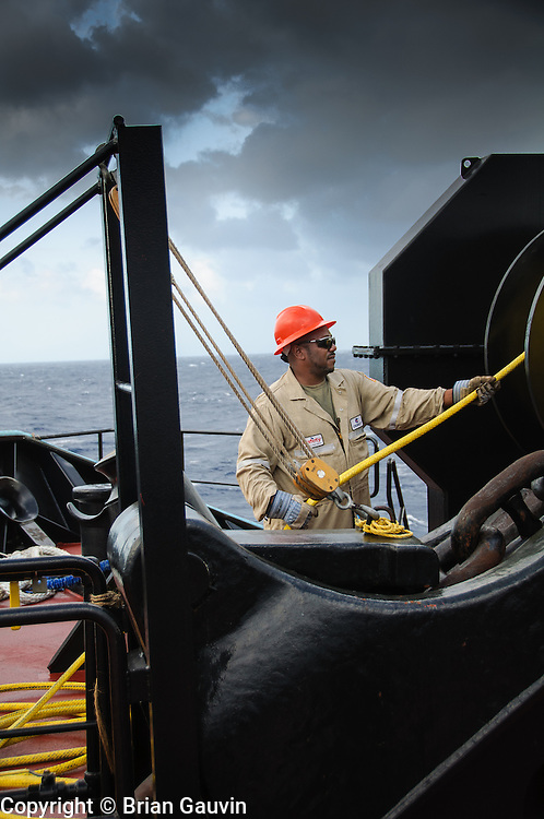 Utility man, Orvin McCoy setting the mooring lines. ATB, Legacy and barge 750-1, Crowley Maritime. Transporting primium and regular grade gasoline from Marathon Oil in Garryville, La. to Port Everglades and Tampa Florida.