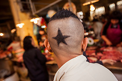A young vietnamese man shows off his trendy haircut, Hanoi, Vietnam, Southeast Asia