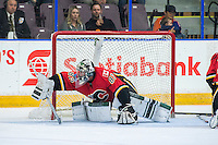 PENTICTON, CANADA - SEPTEMBER 17: Tyler Parsons #82 of Calgary Flames defends the net against the Edmonton Oilers on September 17, 2016 at the South Okanagan Event Centre in Penticton, British Columbia, Canada.  (Photo by Marissa Baecker/Shoot the Breeze)  *** Local Caption *** Tyler Parsons;