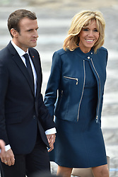 French President Emmanuel Macron with Brigitte Macron attend the annual Bastille Day military parade on the Champs-Elysees avenue in Paris on July 14, 2017. Photo by Lionel Hahn/ABACAPRESS.com