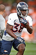 SHOT 7/25/13 9:29:33 AM - Denver Broncos rookie running back Montee Ball #38 runs through drills during opening day of the team's training camp July 25, 2013 at Dove Valley in Englewood, Co.  (Photo by Marc Piscotty / © 2013)