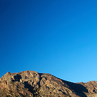 Mexico, Baja California Sur, Loreto. Moon over Baja landscape at Villa del Palmar Loreto.