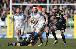 Will Welch of Newcastle Falcons is tackled by Julian Salvi of Exeter Chiefs.  - Mandatory byline: Alex Davidson/JMP - 12/03/2016 - RUGBY - Sandy Park -Exeter Chiefs,England - Exeter Chiefs v Newcastle Falcons - Aviva Premiership