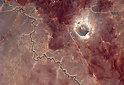 How aliens see us: Planet Earth, as viewed by International Space Station astronauts<br /> <br /> Tweeting from orbit has, it seems, become an important part of any self respecting astronaut's daily routine.<br /> But as these incredible images show, the results really are worth it. <br /> In a trend pioneered by Canadian ISS commander Chris Hadfield, new recruits are now tweeting regularly from orbit.<br /> Astronaut Reid Wiseman, who is currently aboard the station, is a prolific snapper, along with his German colleague Alexander Gerst. <br /> The pair have even developed their own styles, with Gerst preferring abstract patterns on the Earth's surface, while Wiseman favours storms and cities.<br /> Recently Gerst took part in a live Facebook Q&A to answer questions from people on Earth.<br /> One included Sir Richard Branson, who asked: 'What do you think the role of astronauts will be in 50 years' time? Pioneers? Guides? Or the norm?'<br /> Gerst responded: 'My hope would be that in 50 years from now, space travellers will not only be professional agency astronauts, but that everybody should have a realistic chance to make the incredible experience I am having right now.<br /> 'Anyway, I hope there will still be pioneers out there who will fly to destinations farther away.'<br /> <br /> Photo shows: Astronaut Alexander Gerst posted this photo to Facebook from the International Space Station on Aug. 18, 2014 with the caption, 'Picturesque, but only a tiny display of cosmic destruction power. (Barringer Crater, USA)'<br /> ©Alexander Gerst/Exclusivepix