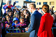 Crowds in Whitehorse watch as the royal couple tour the downtown area.