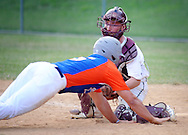 Northampton catcher Jack Seibert tags out Upper Moreland's AJ Shapiro in the fourth inning Wednesday, June 15, 2016 in Upper Moreland, Pennsylvania.   (Photo by William Thomas Cain)