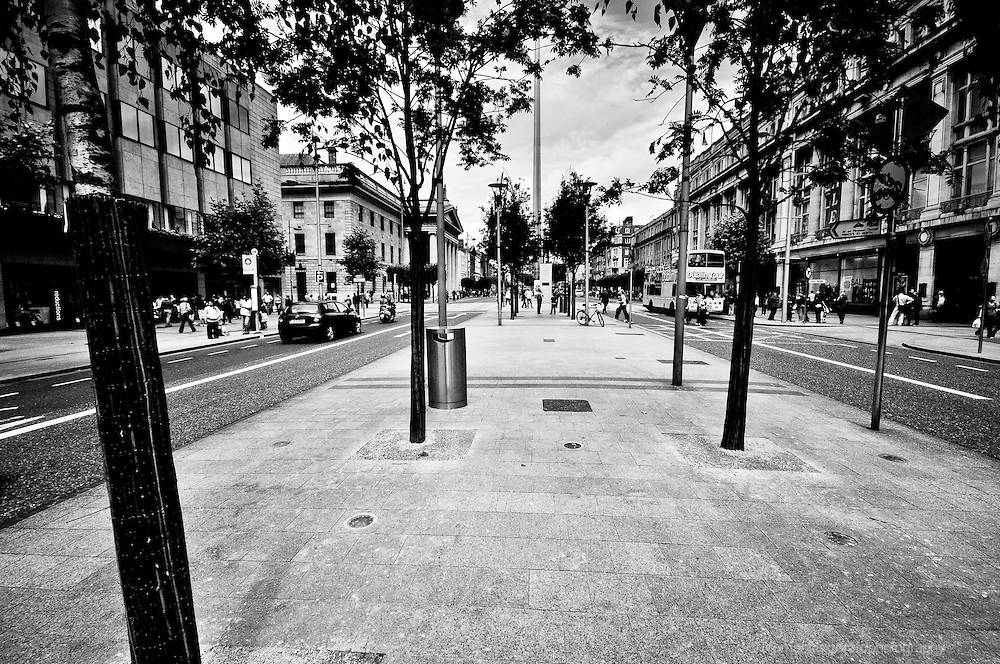 Dublin City, Ireland: A shot of O'Connell Street, Dublin, from the Centre Aisle looking up towards the spire among the trees lining the street.