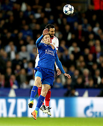 Jamie Vardy of Leicester City challenges Pablo Sarabia of Sevilla to a header - Mandatory by-line: Robbie Stephenson/JMP - 14/03/2017 - FOOTBALL - King Power Stadium - Leicester, England - Leicester City v Sevilla - UEFA Champions League round of 16, second leg