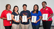 Winners of the Houston ISD HealthWage monthly weight loss contest display their prizes, May 5, 2014.