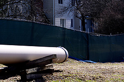 Protective boundaries divide a residential area and the Mariner East 2 pipeline construction site in West Chester, Pennsylvania, on March 13, 2019. In March Pennsylvania state attorney general and Delaware County district attorney launched criminal investigation into Sunoco Logistic Partners and Energy Transfer LP, alleging misconducts in the project realization of Mariner East Pipeline system.