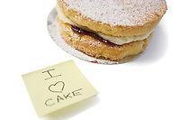 Cake slice with 'I love cake' sign on sticky notepaper