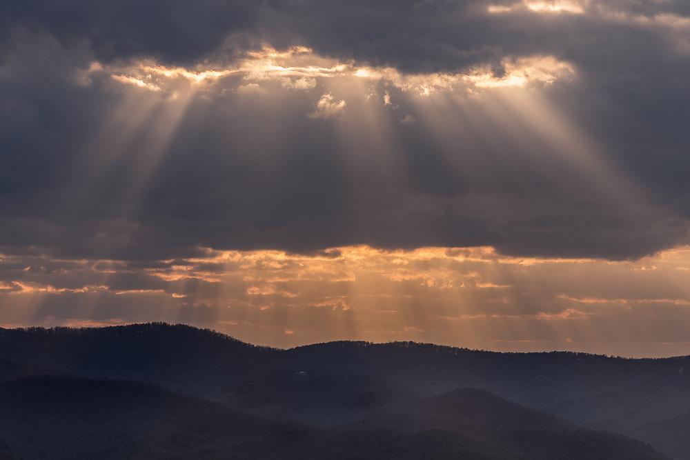 Sunlight shining through clouds