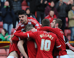 Swindon players celebrate John Swift's goal in the Sky Bet League One match between Swindon Town and Chesterfield at The County Ground on January 17, 2015 in Swindon, England. - Photo mandatory by-line: Paul Knight/JMP - Mobile: 07966 386802 - 17/01/2015 - SPORT - Football - Swindon - The County Ground - Swindon Town v Chesterfield - Sky Bet League One