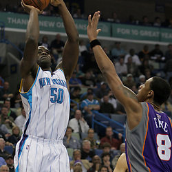 Nov 19, 2009; New Orleans, LA, USA;  New Orleans Hornets center Emeka Okafor (50) shoots over Phoenix Suns center Channing Frye (8) during the first quarter at the New Orleans Arena. Mandatory Credit: Derick E. Hingle-US PRESSWIRE