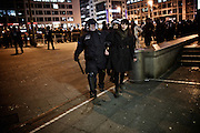Frankfurt am Main | 02 Feb 2015<br /> <br /> Am Montag (02.02.2015) demonstrierten in Frankfurt an der Hauptwache etwa 60 PEGIDA-Anh&auml;nger mit teils extrem rassistischen Reden und Parolen z.B: gegen &quot;Islamisierung&quot;, an den Aktionen gegen die Rechtsextremisten nahmen mehrere tausend Menschen teil.<br /> Hier: Polizeibeamte f&uuml;hren eine Gegendemonstrantin ab, die angeblich mit einer Flasche geworfen hat.<br /> <br /> &copy;peter-juelich.com<br /> <br /> [No Model Release | No Property Release]