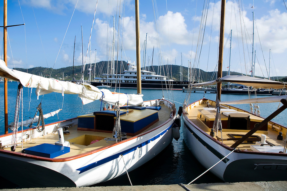 Mega yachts and traditional boats sit on the dock of Antigua Yacht Club in Falmouth Harbor,  Antigua in the British West Indies. Antigua is a yachting haven, historically a British navy base in the times of Nelson.