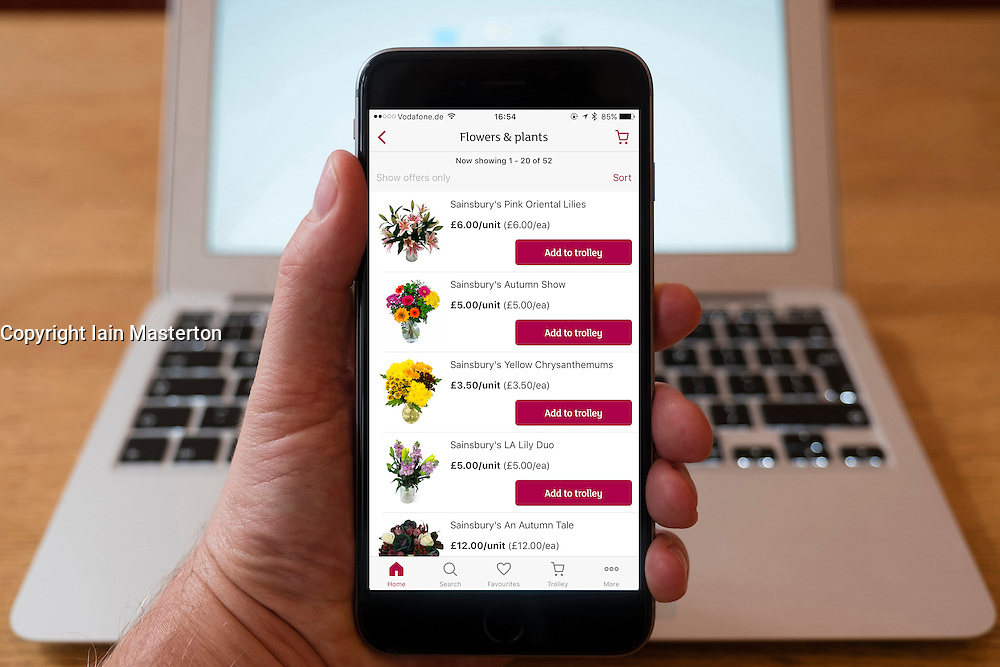 Using iPhone smartphone to display Sainsbury's online groceries shopping app