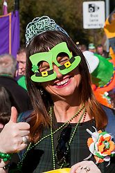 © Licensed to London News Pictures. 16/03/2014. Birminham, UK. Tens of thousands flock to St. Patrick's Day Parade, the highlight of St. Patricks Festival Birmingham - a three week celebration of Irish culture. Established in 1996, St. Patricks Festival Birmingham is a not for profit organisation put on by mainly voluntary staff and funded with sponsorship from Birmingham City Council, local businesses, community organisations and grant making organisations. The theme this year is Irish Myths and Legends and the Parade will be led by Olliphoist, an Irish Dragon. Photo credit : Graham M. Lawrence/LNP