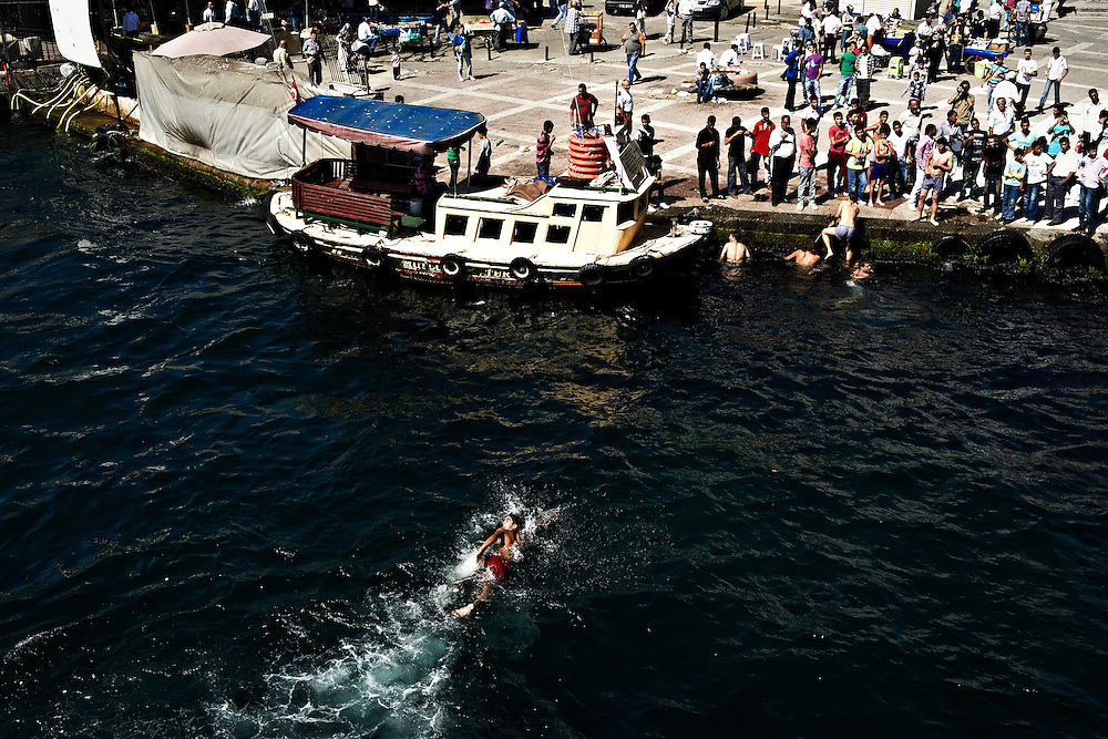 Boys swimming in Karakoy during the Seker Bayram, a three-day festival at the end of Ramadan, Istanbul, Turkey.