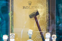 © Licensed to London News Pictures. 05/06/2018. London, UK. A hammer is seen stuck in the glass of a Rolex watch cabinet at Watches of Switzerland in Central London after it was attacked by a gang on mopeds. It is being reported that the attackers were armed with knives. Photo credit: Rob Pinney/LNP