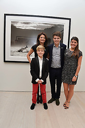 ELIZABETH OFFORD and her children, ROBBIE OFFORD, TOM OFFORD and KATE OFFORD at a private view of photographs by wildlife photographer David Yarrow included in his book 'Encounter' held at The Saatchi Gallery, Duke of York's HQ, King's Road, London on 13th November 2013.