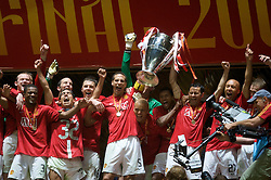 MOSCOW, RUSSIA - Wednesday, May 21, 2008: Manchester United's Rio Ferdinand and Ryan Giggs lift the European Cup after beating Chelsea on sudden death penalties during the UEFA Champions League Final against Chelsea at the Luzhniki Stadium. (Photo by David Rawcliffe/Propaganda)