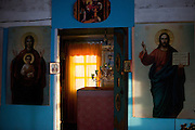 Inside of a Russian orthodox church and the museum of the political exile at the village of Cherkekh somewhere on the way in between the city of Yakutsk and Khandyga at the Kolyma highway in Yakutia. Yakutsk (Russian: ???????) is a city in the Russian Far East, located about 4° (450 kilometres) south of the Arctic Circle. It is the capital of the Sakha (Yakutia) Republic in Russia with a major port on the Lena River. The city has a population of 264.000 (2009). Yakutsk is one of the coldest cities on Earth. The average monthly winter temperature in January is around -43,2 °C. Cherkekh, Jakutien, Yakutia, Russian Federation, Russia, RUS, 17.01.2010.