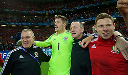LILLE, FRANCE - Friday, July 1, 2016: Wales players celebrate in the team huddle following a 3-1 victory over Belgium and reaching the Semi-Final during the UEFA Euro 2016 Championship Quarter-Final match at the Stade Pierre Mauroy. Kevin McCusker, goalkeeper Wayne Hennessey, Medical Officer Doctor Jon Houghton, Simon Church. (Pic by David Rawcliffe/Propaganda)