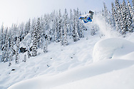 Professional snowboarder Mark Landvik soars above a field of pillows in the Kootenay Mountains of British Columbia while filming his segment of the upcoming Standard Films movie.