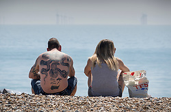 © Licensed to London News Pictures. 05/05/2018. Worthing, UK. Beach goers enjoy the sunshine in Worthing Pier. Record temperatures are expected this bank holiday weekend. Photo credit: Peter Macdiarmid/LNP