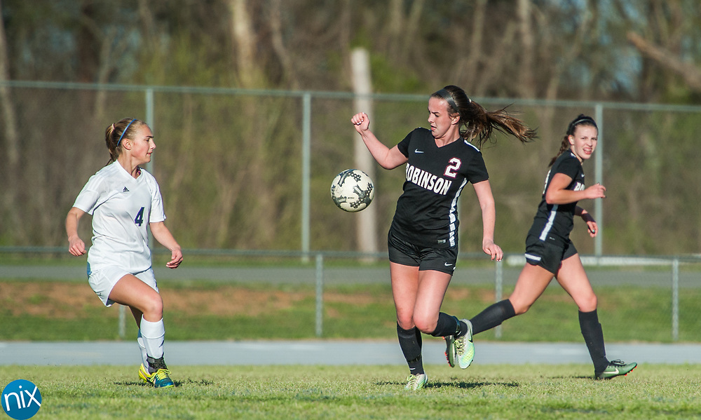Jay M. Robinson's Paige Manzi (2) moves the ball Hickory Ridge Friday night at Hickory Ridge High School in Harrisburg. The game ended in a 2-2 draw after double overtime.