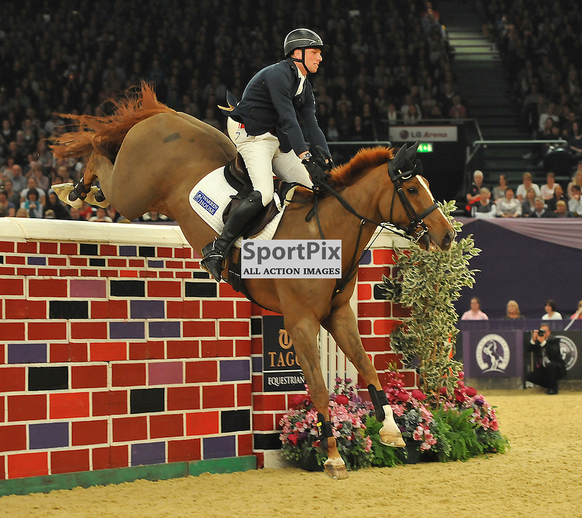 Michael Lonsdale riding Loughnatousa W B in The Tagg Puissance. With the wall being at a height of 1.93mtrs.<br /> Taken at the 2013 International Horse of the year show on the 11th October2013 at the LG Arena (NEC) in Birmingham.<br /> WAYNE NEAL | SPORTPIX.ORG.UK