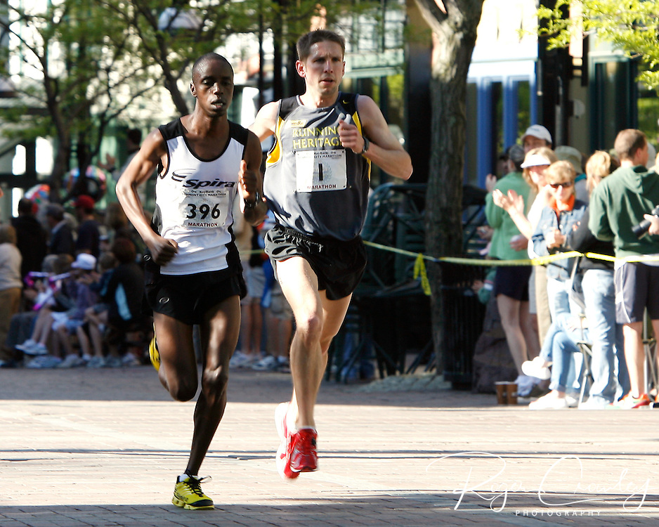 Roger Crowley/Times Argus.Matt Pelletier (right) of Rhode Island and Hilary Lelei of Kenya race up Church Street in the 20th Keybank Vermont City Marathon Sunday. Pelletier won his third straight KeyBank Vermont City Marathon in an unofficial time of 2 hours, 20 minutes, 43 seconds. Lelei came in third unoffficially in 2:24:28.