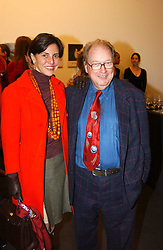 LORD & LADY MCALPINE at an exhibition of photographs by Matthew Mellon entitled Famous Feet - featuring well known people wearing shoes from Harrys of London, held at Hamiltons Gallery, Carlos Place, London on 22nd November 2004.<br />