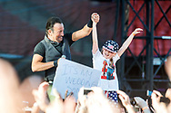 GLASGOW, SCOTLAND - JUNE 01:  Bruce Springsteen  is joined on stage by a young fan while performing at Hampden Park on June 1, 2016 in Glasgow, Scotland.  (Photo by Ross Gilmore/Getty Images)