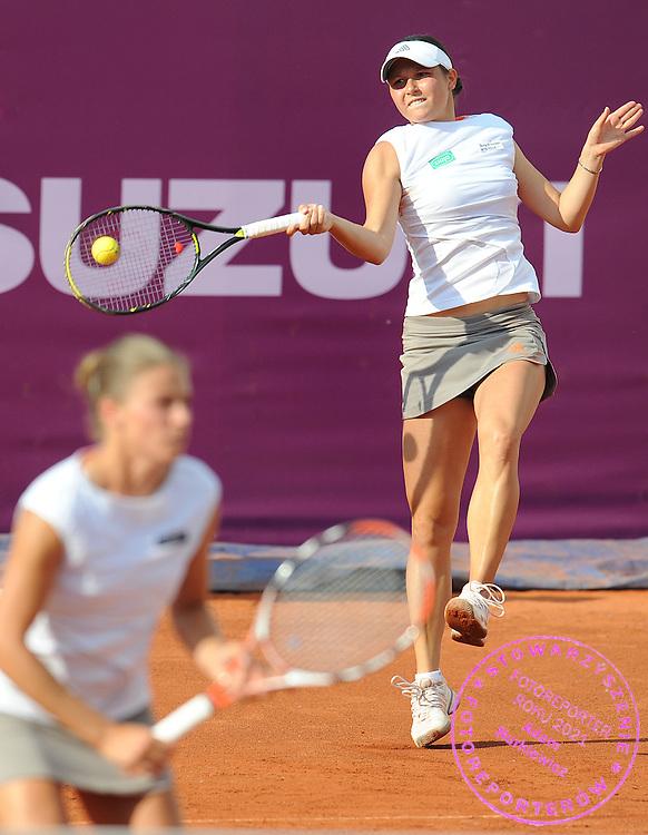 (L) ALICJA ROSOLSKA & (R) KLAUDIA JANS BOTH FROM POLAND DURING DOUBLES TENNIS SONY ERICSSON WTA TOUR TOURNAMENT WARSAW OPEN 2009 IN WARSAW, POLAND...WARSAW , POLAND , MAY 20, 2009..( PHOTO BY ADAM NURKIEWICZ / MEDIASPORT )