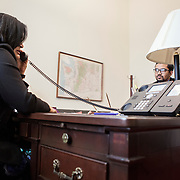 Representative Pramila Jayapal (D-WA, 7) does a phone interview with KOMO Radio, a local Seattle radio station, as Communications Director, Omer Farooque takes notes, on Tuesday, January 31, 2017.  John Boal photo/for The Stranger