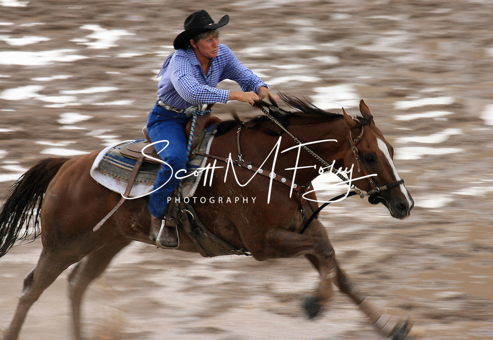 Professional Women's Barrel Racer Vickie Solmonsen, Riverton UT, clears the barrels in 18.20 seconds, 28 July 2007, Cheyenne Frontier Days