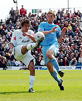 Photo: Kevin Poolman.<br />Milton Keynes Dons v Tranmere Rovers. Coca Cola League 1. 29/04/2006. Dons' Filipe Morais and Danny Harrison fight for the ball.