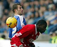 Photo: Chris Ratcliffe.<br />Gillingham v Bristol City. Coca Cola League 1. 26/12/2005.<br />Bas Savage (R) of Bristol City and Jon Wallis of Gillingham battle it out.