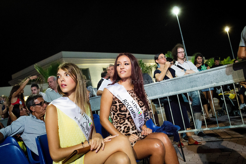 VILLAFRANCA TIRRENA, ITALY - 28 August 2013: Stefania Vincenzi (right), the 18 years old daughter of the missing and presumed dead Costa Concordia cruise ship passenger Mariagrazia Trecarichi, sits here as a juror for the Sicilian regional selections of Miss Italy, in Villafanca Tirrena, Italy, on August 28th 2013. Stefania Vincenzi was selected as one of the Sicilian representatives who will participate at the final selections of Miss Italy in Salso Maggiore in September 2013. The idea of participating at the beauty pageant came after Mariagrazia Trecarichi met a friend who organizes the local castings who told her Stefania suited the contest.
