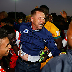 Maritzburg United celebrates  with Eric Tinkler (Head Coach) of Maritzburg Utd after retaining their PSL status during the Premier Soccer League (PSL) promotion play-off  match between  Royal Eagles and Maritzburg United F.C. at the Chatsworth Stadium Durban.South Africa,29,05,2019